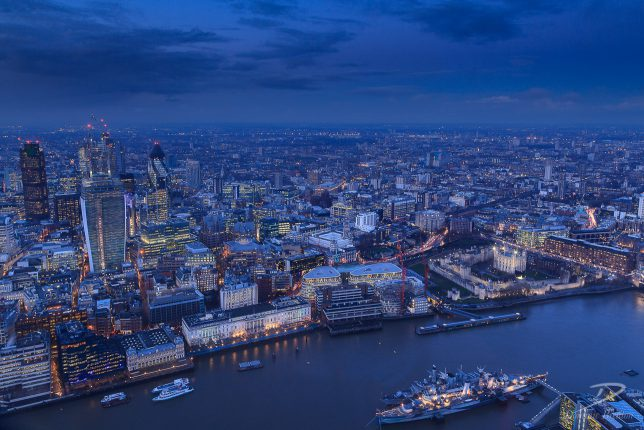 The City of London and Tower of London illuminated by office and street lights.