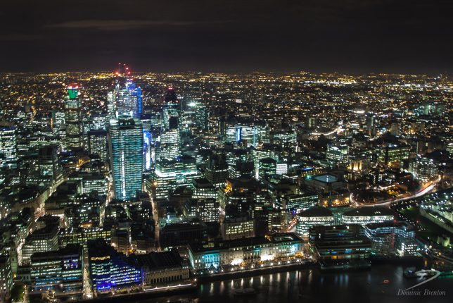Skyscrapers in the City of London, including the Walkie Talkie, shot at night from The Shard.