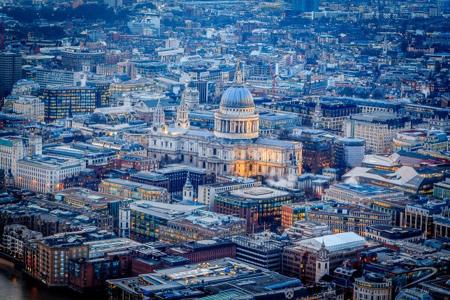 St. Paul's Cathedral surrounded by offices in the City of London at dusk, photographed from The Shard.
