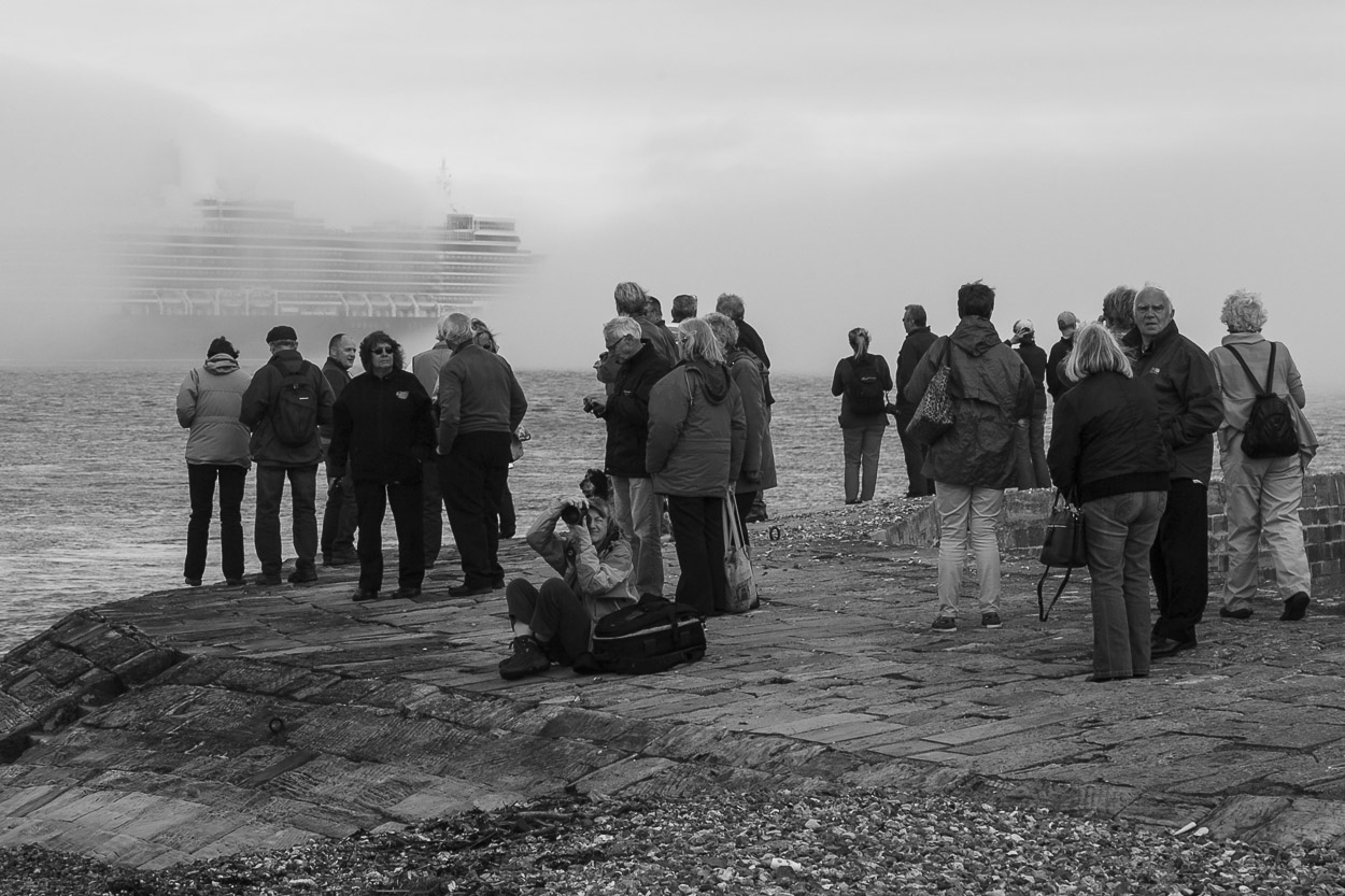 Bystanders at Calshot Castle watching three Cunard Liners set saail