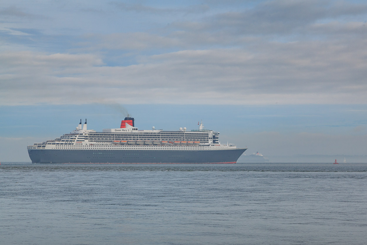 Queen Mary 2 trails her sister ship Queen Victoria out of Southampton Water.