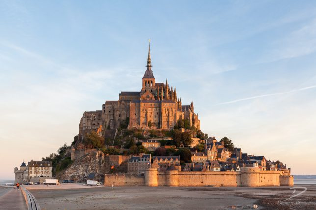 Mont St. Michel glowing gold in the early morning sun
