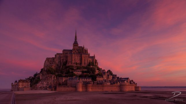 Mont St. Michel at dawn with a pretty pink sky