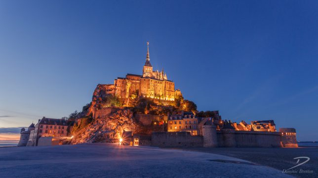 Wide-angle shot of Mont St. Michel as night approaches