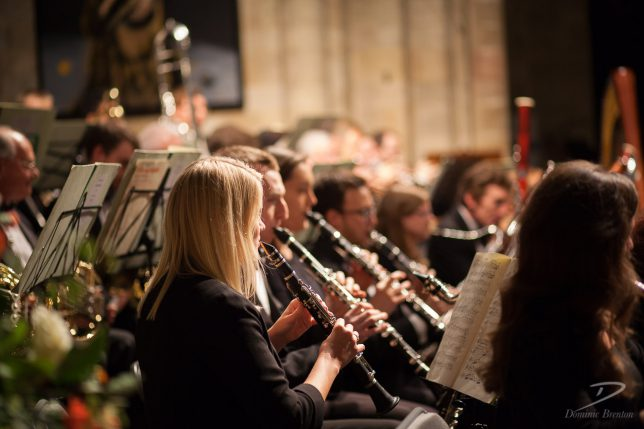 Blonde clarinettist in the Charity Symphony Orchestra
