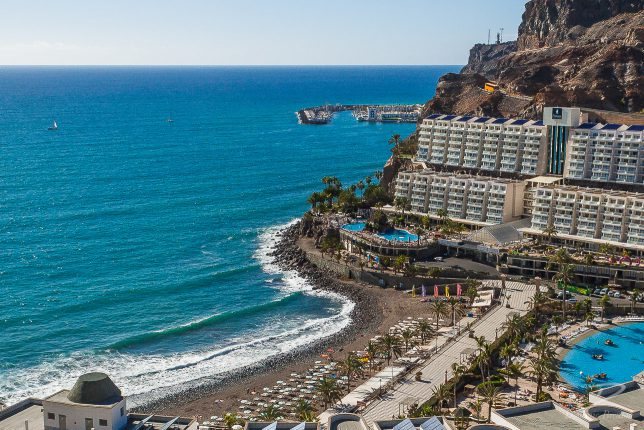 Beach, promemade, large hotel, blue sea and sky