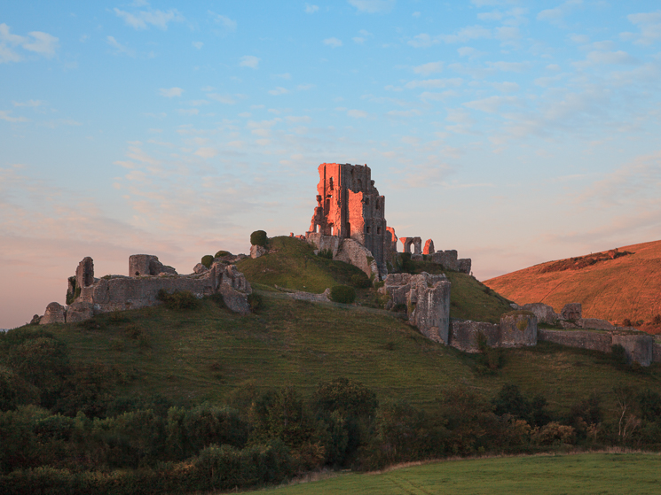 Corfe Castle, Dorset, at sunset, viewed from the south