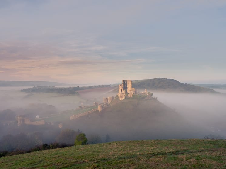 Corfe Castle wreated in autumnal early-morning mist
